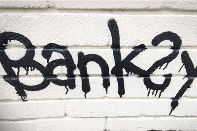 Banksy's shredded painting resold for record $25.4M